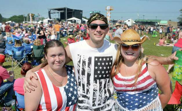 Samantha Bolio, left, Ryan Quail and Hailey Connor pose for a photo during the 22nd Annual CountryFest at the Schaghticoke Fair Grounds Saturday July 11, 2915 in Schaghticoke, NY.  (John Carl D'Annibale / Times Union) Photo: John Carl D'Annibale / 00032548A