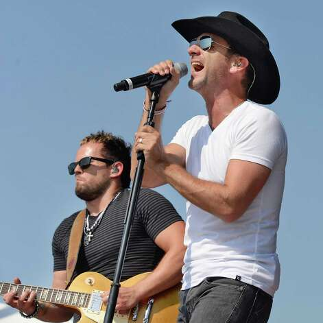 Country star Craig Campbell, right, performs at the 22nd Annual CountryFest at the Schaghticoke Fair Grounds Saturday July 11, 2915 in Schaghticoke, NY.  (John Carl D'Annibale / Times Union) Photo: John Carl D'Annibale / 00032548A