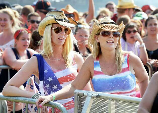 Lori Nicola, left, and Sharon Dudwoire of Brinswick sing along with country star Craig Campbell during the 22nd Annual CountryFest at the Schaghticoke Fair Grounds Saturday July 11, 2915 in Schaghticoke, NY.  (John Carl D'Annibale / Times Union) Photo: John Carl D'Annibale / 00032548A