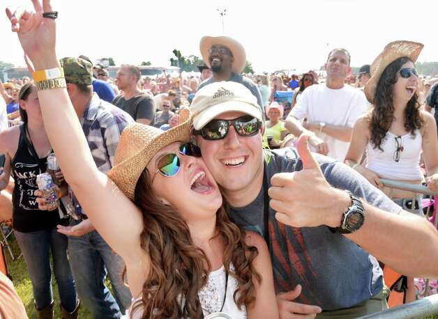 Alyssa Rose,left, of Ganesvoort poses with Paul Freidel of Boston during the 22nd Annual CountryFest at the Schaghticoke Fair Grounds Saturday July 11, 2915 in Schaghticoke, NY.  (John Carl D'Annibale / Times Union) Photo: John Carl D'Annibale / 00032548A