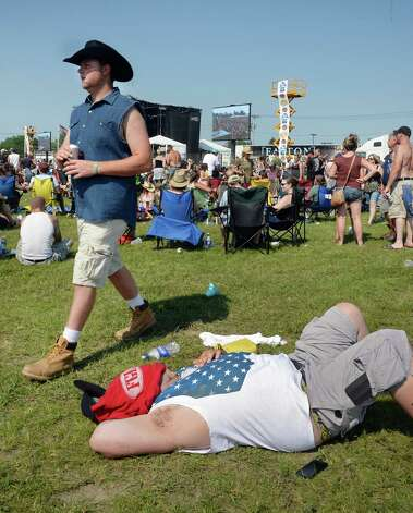 A fan rests in the heat between performances at the 22nd Annual CountryFest at the Schaghticoke Fair Grounds Saturday July 11, 2915 in Schaghticoke, NY.  (John Carl D'Annibale / Times Union) Photo: John Carl D'Annibale / 00032548A