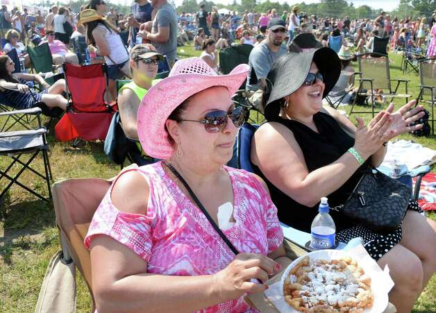 Sisters Domenica Terry, left, and Yolanda Terry of Rensselaer enjoy the music during the 22nd Annual CountryFest at the Schaghticoke Fair Grounds Saturday July 11, 2915 in Schaghticoke, NY.  (John Carl D'Annibale / Times Union) Photo: John Carl D'Annibale / 00032548A