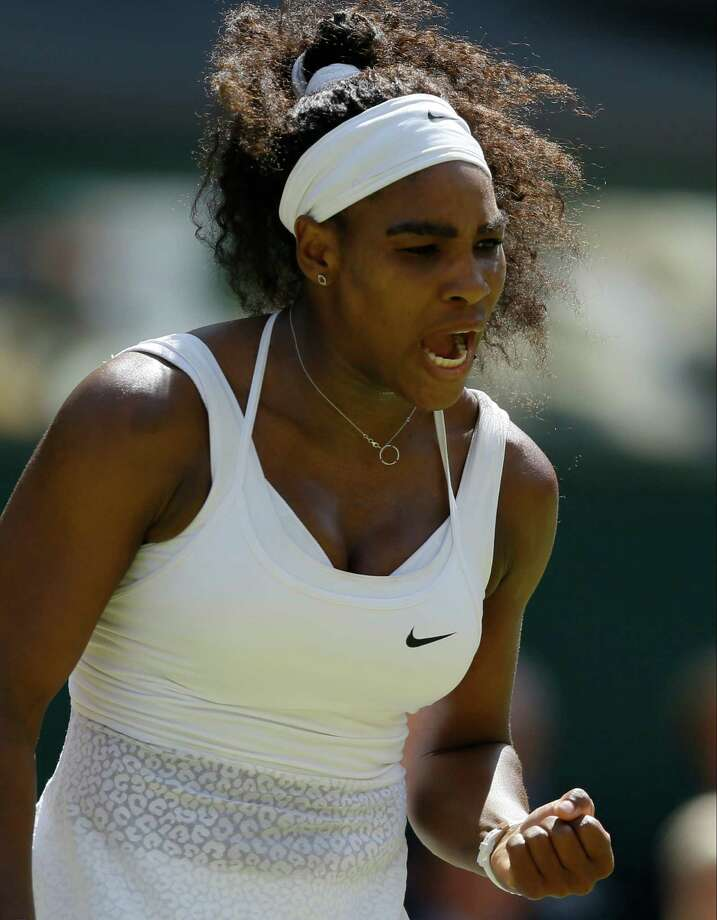 Serena Williams of the United States celebrates winning a point against Garbine Muguruza of Spain, during the women's singles final at the All England Lawn Tennis Championships in Wimbledon, London, Saturday July 11, 2015. (AP Photo/Kirsty Wigglesworth) ORG XMIT: WIM126 Photo: Kirsty Wigglesworth / AP