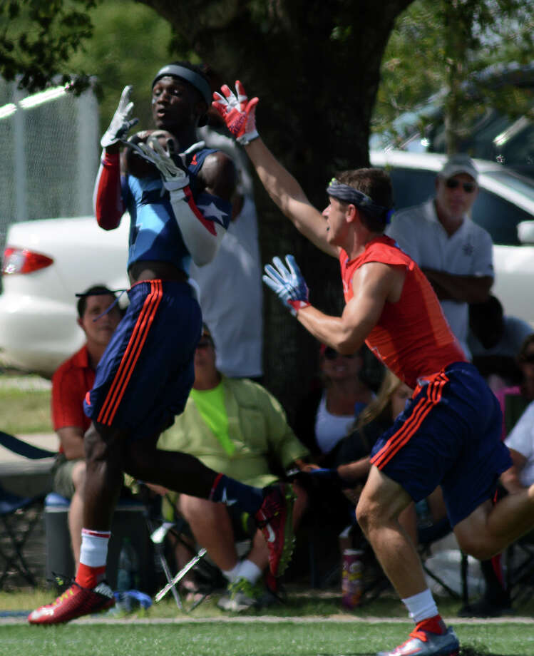 Manvel senior wide receiver Reggie Hemphill, left, goes up to catch a touchdown pass against an Austin Westlake defender during their Division I championship game at the state 7-on-7 football tournament at Veterans Park and Athletic Complex in College Station on Saturday, July 11, 2015. (Photo by Jerry Baker/Freelance) Photo: Jerry Baker, Freelance