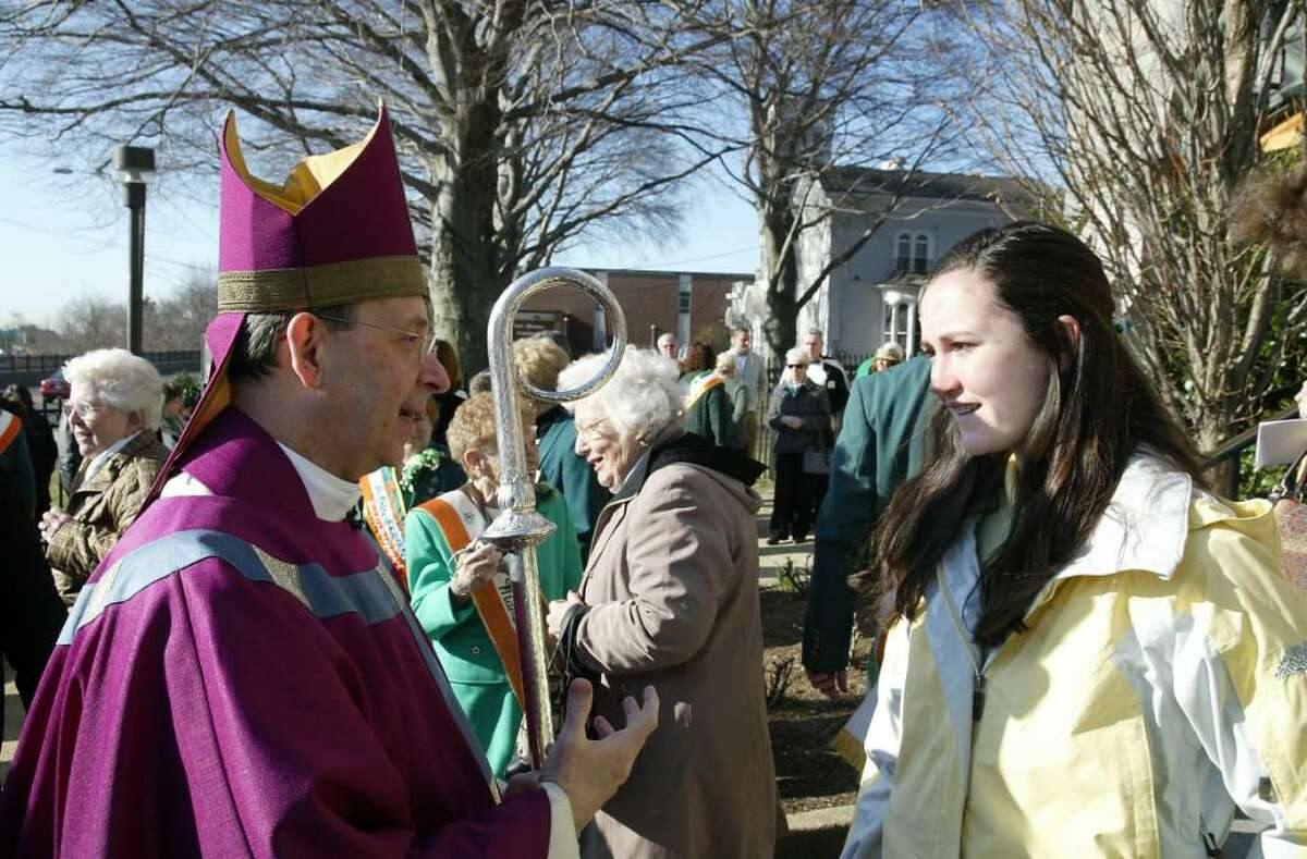 Bishop William E. Lori speaks with Kelly Burns, 14, from Fairfield, Wed., March 17, 2010, after St. Patrick's Day Mass at St. Augustine Cathedral in Bridgeport.