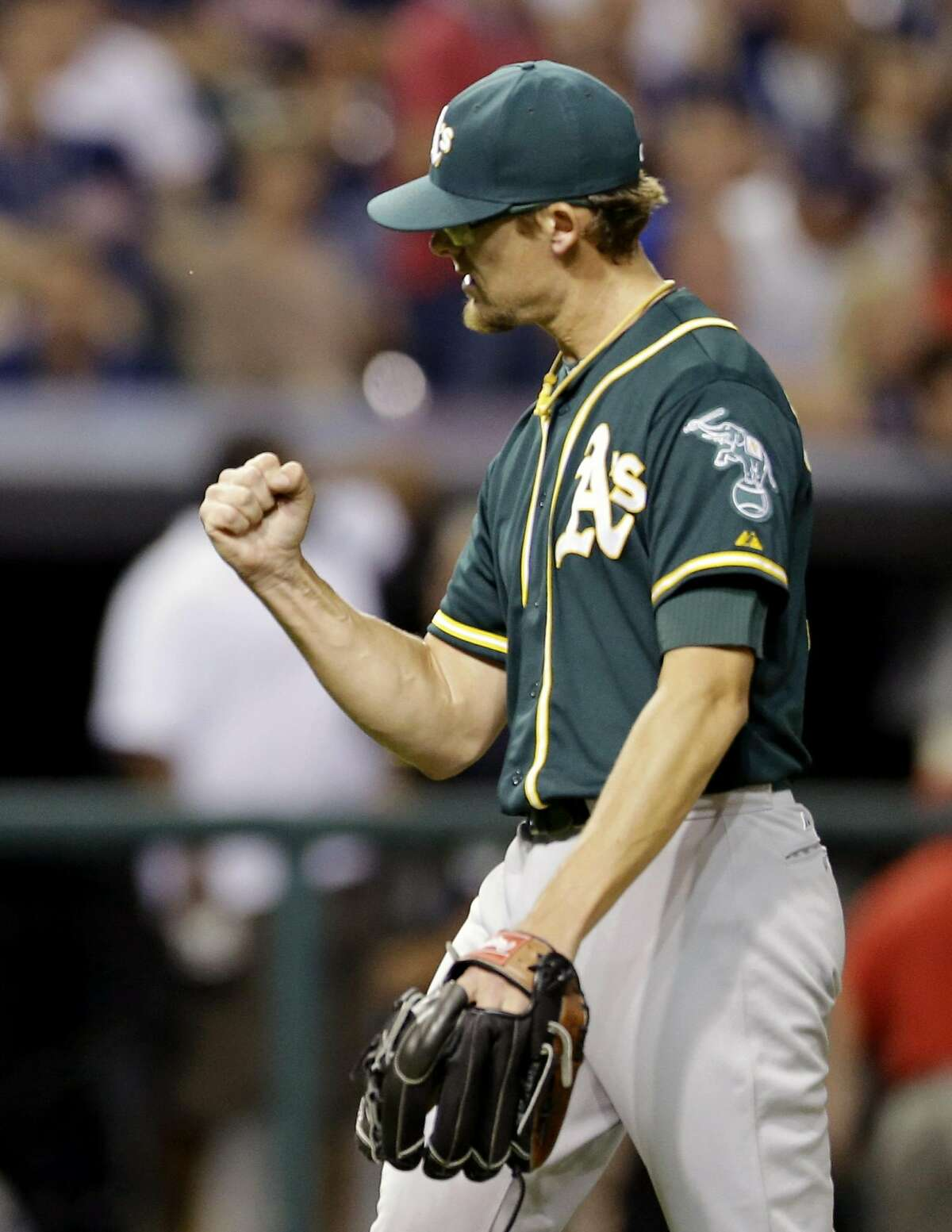Oakland Athletics relief pitcher Tyler Clippard pumps his fist after the Athletics defeated the Cleveland Indians 5-4 in a baseball game, Saturday, July 11, 2015, in Cleveland.
