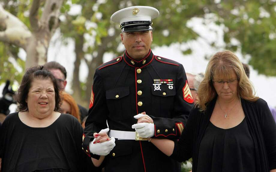 "Retired Marine Sgt. Robert Acosta escorts his mother Dianna Bedwell, left, and sister Debbie Apple, as they arrive at Riverside National Cemetery for a service for Cecil ""Paul"" Knutson on Friday, July 10 2015. Cecil, the Fullerton man who along with his wife Dianna Bedwell, got lost on the way from a San Diego County casino to a relative's home in the Riverside County desert. Cecil passed away in the two-week ordeal and his wife survived. (Stan Lim/The Press-Enterprise via AP) Photo: Stan Lim, MBO / The Press-Enterprise"