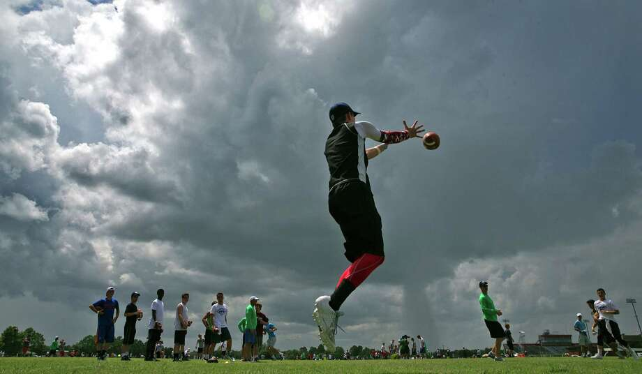 In this photo taken on Friday, July 10, 2015, about 1,200 aspiring quarterbacks, receivers, running backs and tight ends practice and learn football fundamentals during the Manning Passing Academy at Nicholls State University in Thibodaux, La.. The 20th annual camp runs from July 9-12 at Nicholls State University with the perennial leaders - former New Orleans Saints quarterback Archie Manning and his three sons, Cooper and Super Bowl winners Peyton and Eli.  (Ted Jackson/NOLA.com The Times-Picayune via AP) MAGS OUT; NO SALES; USA TODAY OUT; THE BATON ROUGE ADVOCATE OUT; THE NEW ORLEANS ADVOCATE OUT; MANDATORY CREDIT ORG XMIT: LAORS106 Photo: Ted Jackson / NOLA.com The Times-Picayune
