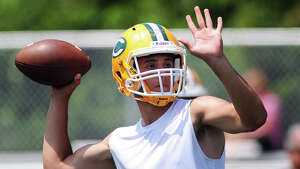 Trinity Catholic quarterback Anthony Lombardi drops back to pass at the annual Grip It and Rip It 7-on-7 passing tournament at New Canaan High School Saturday, July 11, 2015.
