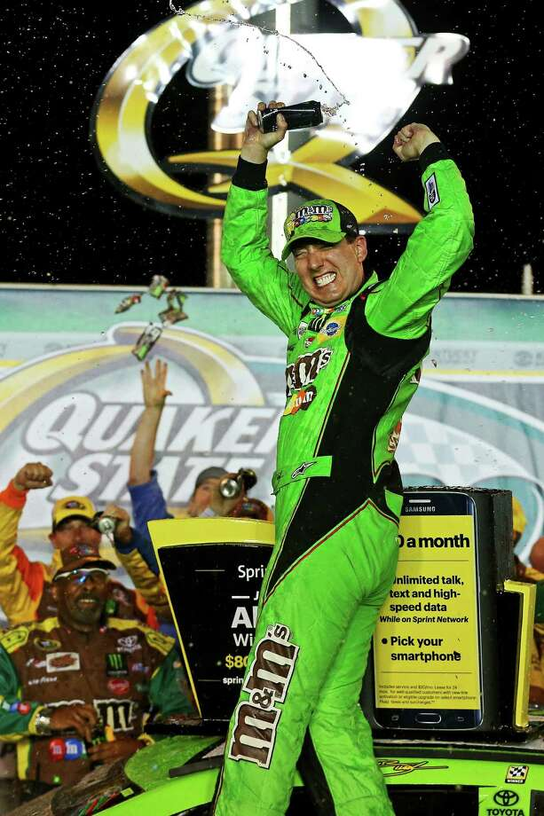 SPARTA, KY - JULY 11:  Kyle Busch, driver of the #18 M&M's Crispy Toyota, celebrates in Victory Lane after winning the NASCAR Sprint Cup Series Quaker State 400 presented by Advance Auto Parts at Kentucky Speedway on July 11, 2015 in Sparta, Kentucky.  (Photo by Sarah Crabill/Getty Images) ORG XMIT: 563781577 Photo: Sarah Crabill / 2015 Getty Images