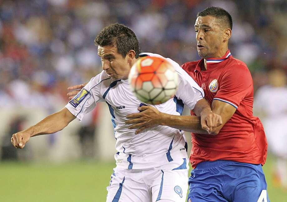El Salvador's Rafael Burgos, left, and Costa Rica's Michael Umana fight for position Saturday night. Photo: Thomas B. Shea, Freelance / © 2015 Thomas B. Shea