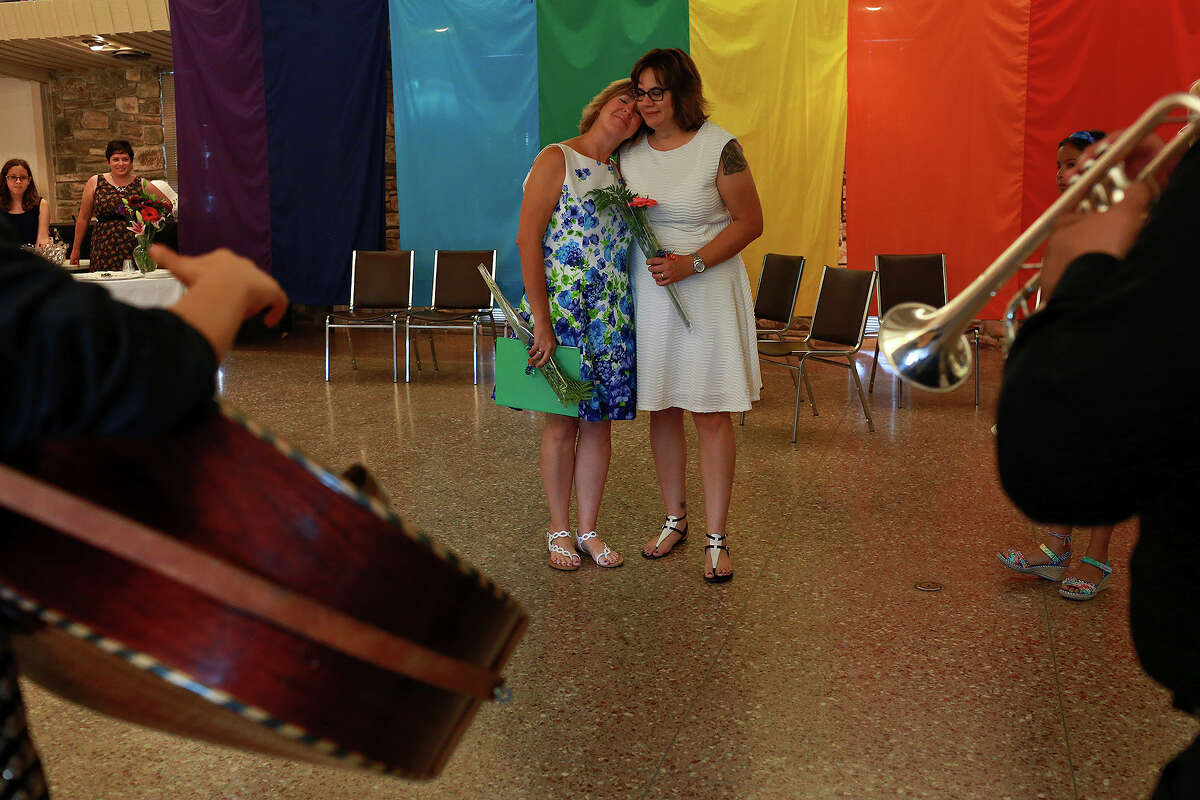 Marianne Laguna, left, and her wife, Chris Laguna, are serenaded by a Mariachi band after their marriage ceremony at First Unitarian Universalist Church of San Antonio on Friday, July 3, 2015.