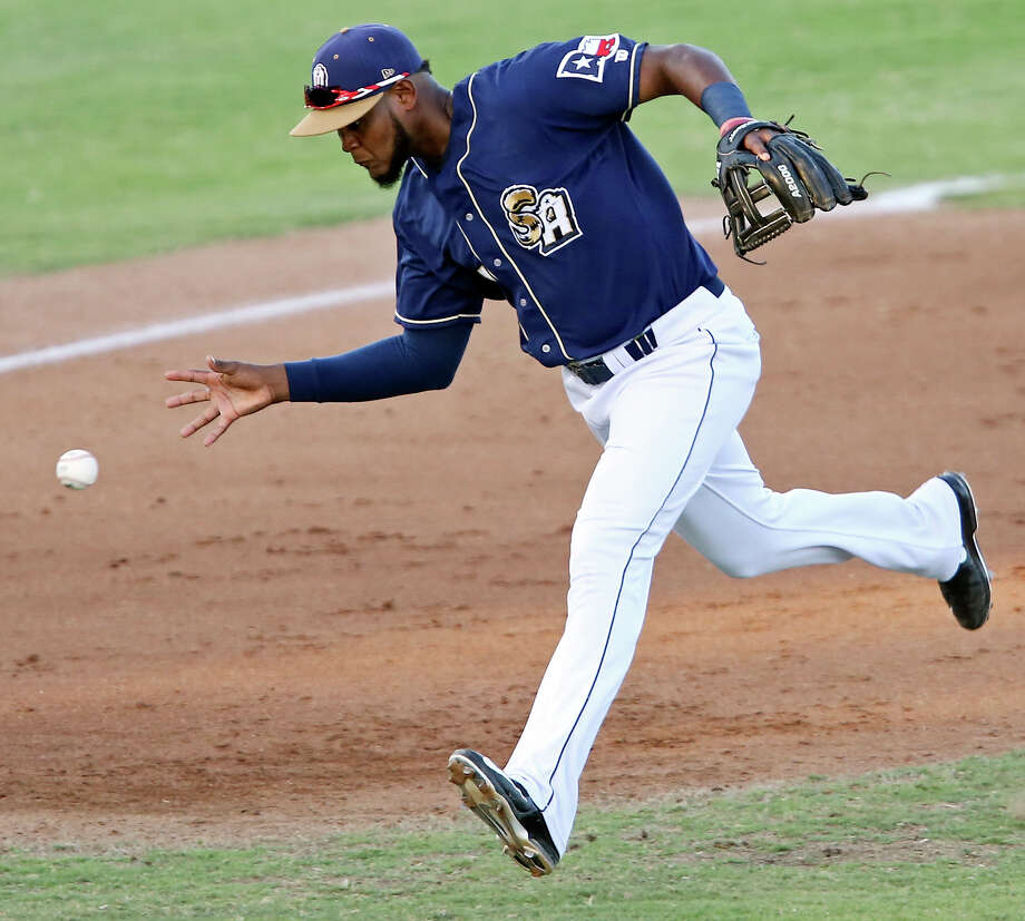 Missions' Duanel Jones makes a barehanded grab on a ball hit by Tulsa Drillers' Yadir Drake during the 6th inning of game 1 of a double-header Saturday July 11, 2015 at Nelson W. Wolff Municipal Stadium. Drake was thrown out at first base. The Missions won 6-2. Photo: Edward A. Ornelas, Staff / San Antonio Express-News / © 2015 San Antonio Express-News