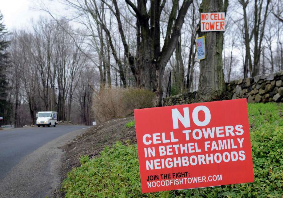 Opponents of a proposed cell tower on a 49-acre property on Codfish Hill Road in Bethel have placed signs around town. Photo: Carol Kaliff / Hearst Connecticut Media / The News-Times
