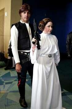 SAN JUAN, PUERTO RICO - MAY 24:  Cosplayers dressed as Han Solo and Princess Leia from Star Wars during Puerto Rico Comic Con at the Puerto Rico Convention Center on May 24, 2015 in San Juan, Puerto Rico.  (Photo by GV Cruz/WireImage) Photo: GV Cruz, Getty Images / 2015 GV Cruz