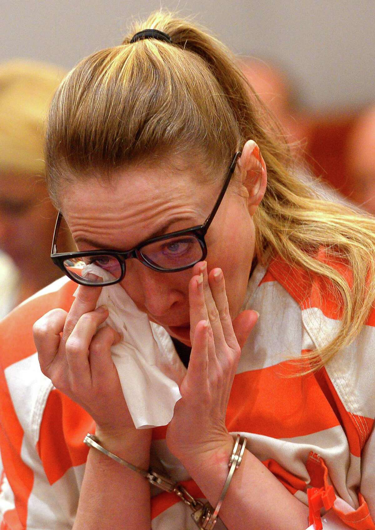 Brianne Altice wipes her eye as she appears in court during her sentencing Thursday, July 9, 2015, in Farmington, Utah. A judge sentenced Altice, a former high school English teacher who pleaded guilty to sexually abusing three male students, to at least two and up to 30 years in prison Thursday. (Leah Hogsten/The Salt Lake Tribune via AP, Pool)
