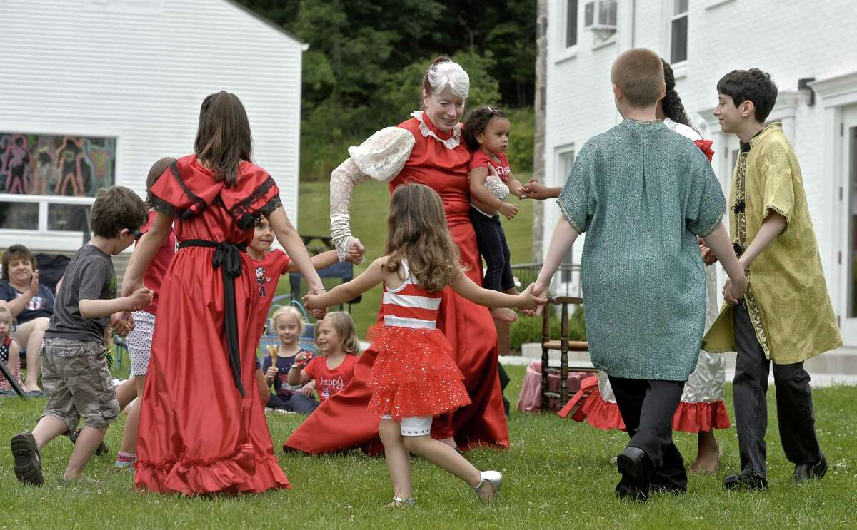 Elyse Jasensky, director of Fairy Tale Theater, plays the part of Mother Goose as she dances with cast members and participants from the audience.