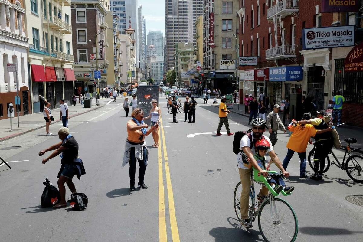 Tenderloin residents and visitors enjoy Sunday Streets, which takes place in various neighborhoods across the city once a month from March to October.