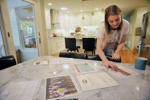 Adriana Schaffer talks about being a White House intern during an interview at her parent's home on Thursday, July 9, 2015, in Slingerlands, N.Y.  On the table are photographs and other items from her internship.   (Paul Buckowski / Times Union) Photo: PAUL BUCKOWSKI / 00032544A