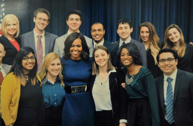 A copy photograph of an image of Adriana Schaffer, front row fourth from left, and other White House interns posing for a photograph with the First Lady.    (Paul Buckowski / Times Union) Photo: PAUL BUCKOWSKI / 00032544A