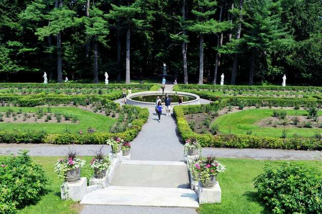 People make their way through the Yaddo Rose and Rock Gardens on Sunday, July 12, 2015, in Saratoga Springs, N.Y.  Yaddo  was one of the locations for the Saratoga Secret Gardens Tour.  The Secret Gardens Tour is sponsored by Soroptimist International of Saratoga County as a fundraiser for the organization.  The Soroptimist International of Saratoga County is an organization made up of business and professional women who work to improve the lives of women and girls in the community.   (Paul Buckowski / Times Union) Photo: PAUL BUCKOWSKI / 00032580A