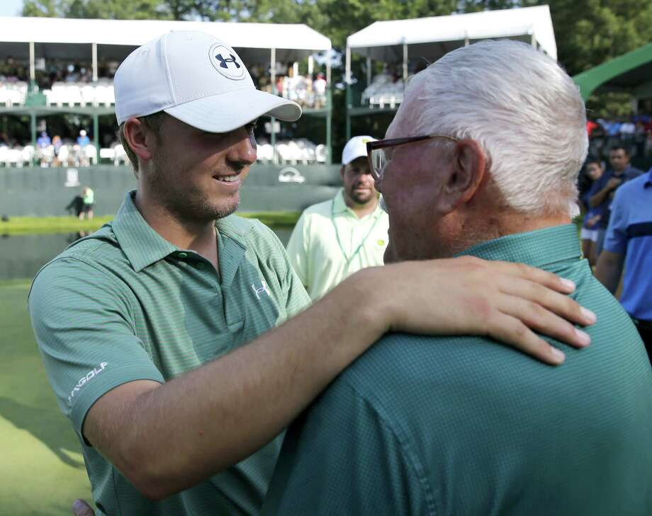 Jordan Spieth, left, receives congratulations from his grandfather, Bob Julius, after the latest achievement in Spieth's spectacular 2015 season. Photo: Charles Rex Arbogast, STF / AP