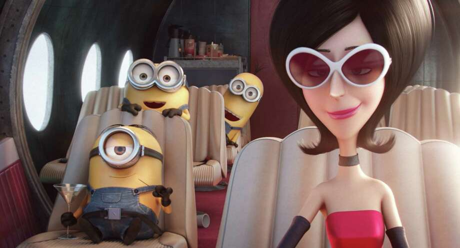 "In this image released by Universal Pictures, characters, from left, Stuart, Bob, Kevin and Scarlet Overkill, voiced by Sandra Bullock, appear in a scene from the animated feature, ""Minions."" Photo: Illumination Entertainment / Universal Pictures"