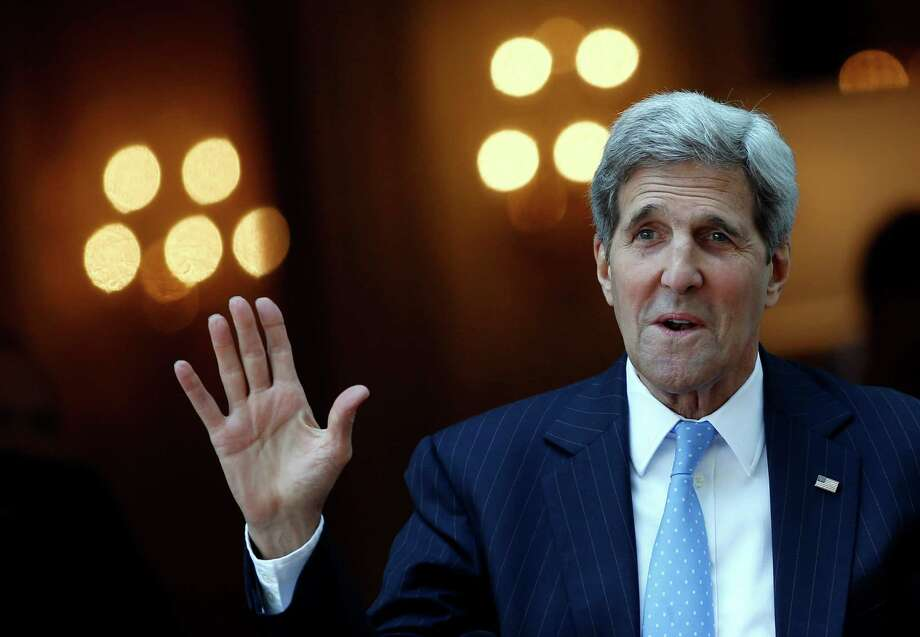 "U.S. Secretary of State John Kerry leaves his hotel on the way to Mass in Vienna. ""We had a very good meeting,"" Kerry said about his Saturday night session with Iran's foreign minister. Photo: Carlos Barria /Associated Press / pool reuters"