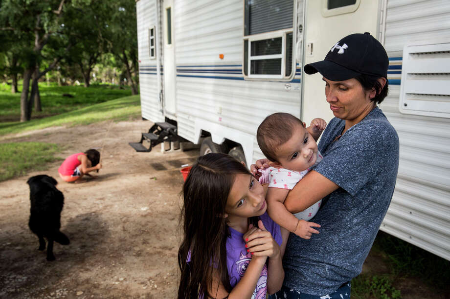 Glenda Bamberger and her daughters, Cielo, 10; Esmebella, 9 months; and Serenity, 7, have been living in an RV in front of their flood-damaged house in Blanco while they wait for their new home to finish being built. Photo: Carolyn Van Houten, Staff / 2015 San Antonio Express-News