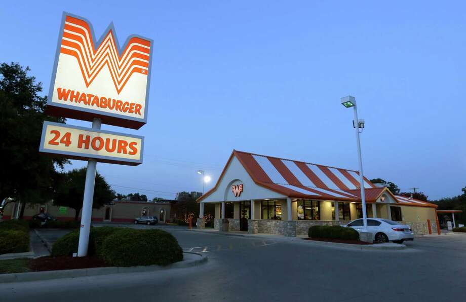 This Thursday, July 9, 2015 photo shows a Whataburger restaurant in San Antonio, Texas. The iconic Texas restaurant chain will not allow the open carrying of guns on its properties, taking a stand against a new law legalizing the practice. (AP Photo/Eric Gay) Photo: Eric Gay, STF / AP