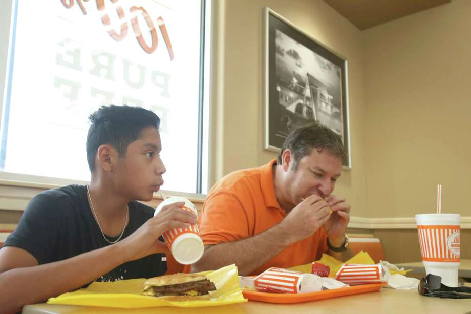 Here's your Whataburger.Wouldn't life be better if someone would just greet you with a No. 1?Pictured: Bill Long, right, and his son eat at Whataburger off Silber Road.  Photo: Dylan Aguilar, Staff / © 2015 Houston Chronicle