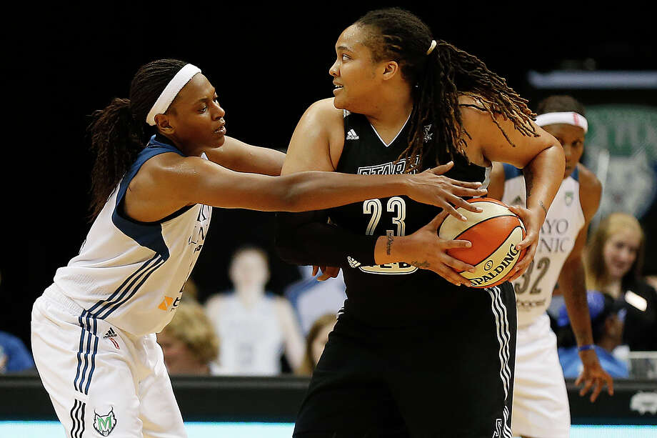 Minnesota Lynx forward Asjha Jones, left, tries to steal the ball from San Antonio Stars forward Danielle Adams (23) during the second half of a WNBA basketball game, Sunday, July 12, 2015, in Minneapolis. The Lynx won 66-49. Photo: Stacy Bengs /Associated Press / FR170489 AP