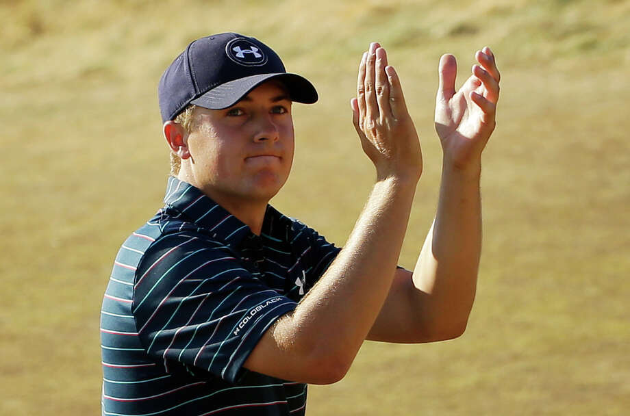 FILE - In this June 21, 2015, file photo, Jordan Spieth claps after finishing the final round of the U.S. Open golf tournament at Chambers Bay in University Place, Wash. Spieth isn't taking the traditional route to the British Open. Rather than prep for St. Andrews in Scotland this weekend, Speith will spend it in the Quad Cities playing the John Deere Classic _ site of his first win as a pro two years ago.   (AP Photo/Ted S. Warren, File) ORG XMIT: NY151 Photo: Ted S. Warren / AP