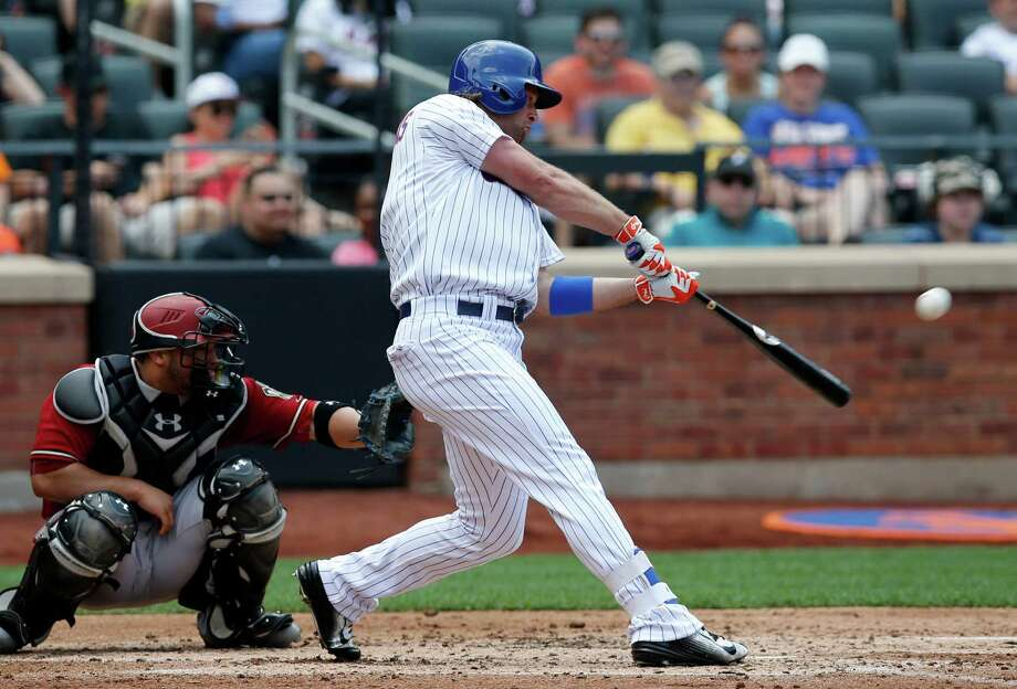 New York Mets Kirk Nieuwenhuis (9) hits a third-inning, two-run home run, his second home run of the game, in a baseball game against the Arizona Diamondbacks in New York, Sunday, July 12, 2015. (AP Photo/Kathy Willens) ORG XMIT: NYM105 Photo: Kathy Willens / AP