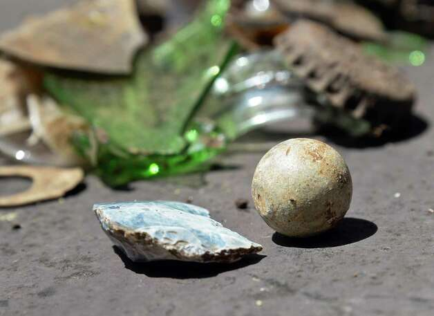 A British military flint, bottom left, and musket ball from the 18th Century found amid the debris of tourism during an archaeological dig at Lake George Battlefield Park in Lake George, NY.  (John Carl D'Annibale / Times Union) Photo: John Carl D'Annibale / 00032466A