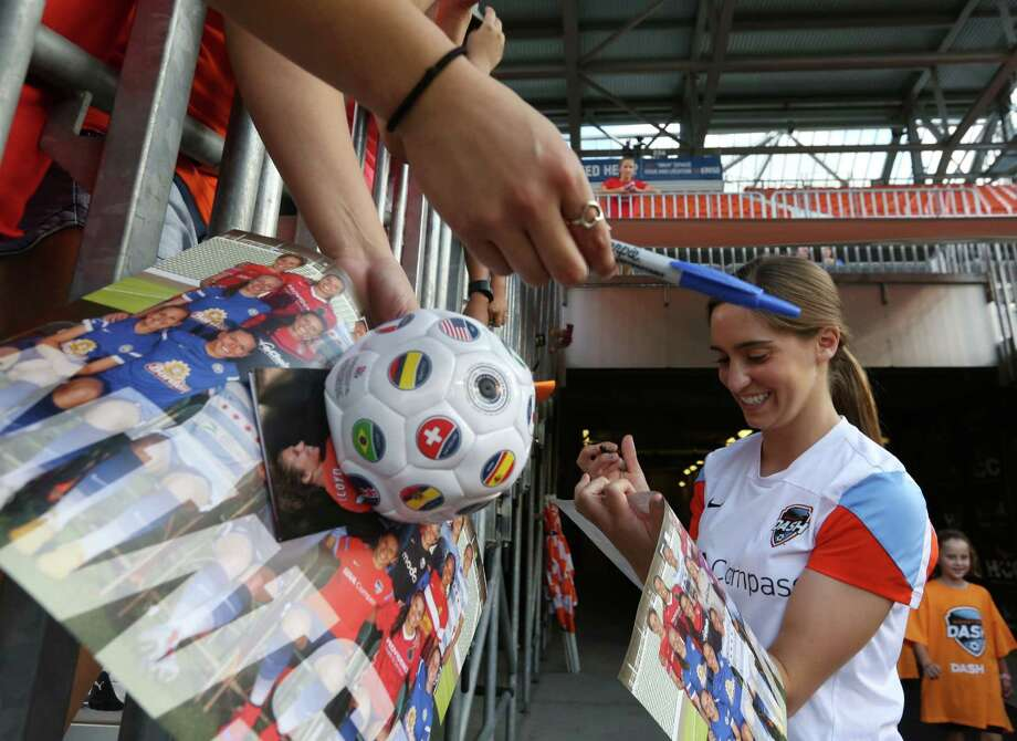 Houston Dash midfielder Morgan Brian, also a mem-ber of the world champion U.S. women's soccer team, signs autographs Sunday at BBVA Compass Stadium. Photo: Jon Shapley, Staff / © 2015 Houston Chronicle