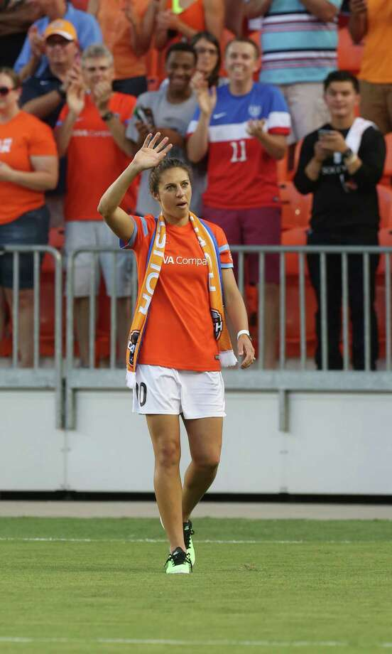 World Cup MVP Carli Lloyd receives a warm welcome from the crowd of 13,025 at BBVA Compass Stadium on Sunday night. Photo: Jon Shapley, Staff / © 2015 Houston Chronicle