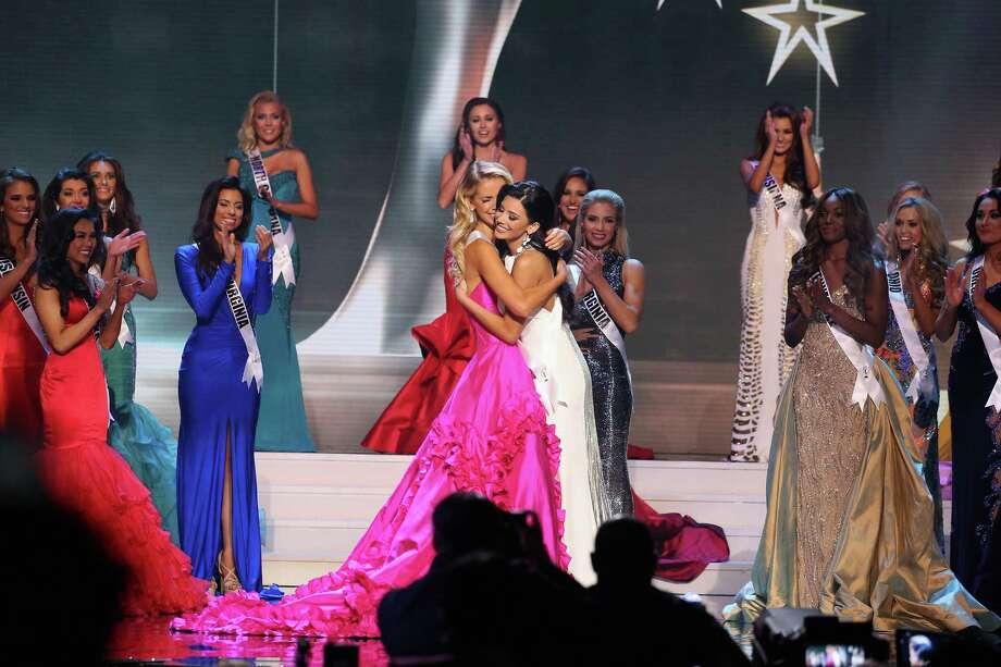Miss Texas Ylianna Guerra, right, congratulates Miss Oklahoma Olivia Jordan, the new Miss USA. Photo: Josh Brasted, Stringer / 2015 Getty Images