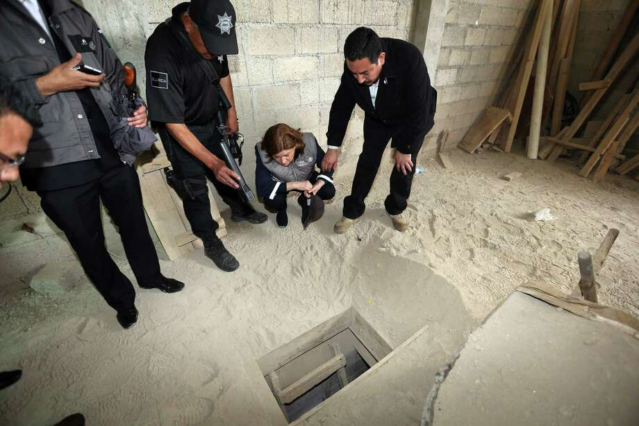 Mexican Attorney General Arely Gomez crouches down while examining the entrance to the escape tunnel under the prison. Photo: Attorney General Of Mexico /AFP Photo / AFP
