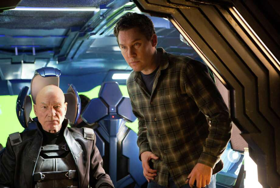 "This image released by 20th Century Fox shows director Bryan Singer, right, with actor Patrick Stewart on the set of ""X-Men: Days of Future Past."" (AP Photo/20th Century Fox, Alan Markfield) ORG XMIT: NYET123 Photo: Alan Markfield / 20th Century Fox"