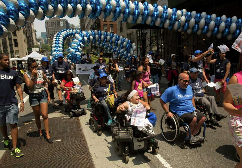 Participants in the inaugural NYC Disability Pride Parade in New York, July 12, 2015. The city hosted its first parade Sunday supporting people with disabilities, with more than 3,000 participants heading up Broadway using wheelchairs, canes and guide dogs. The grand marshal was former U.S. Sen. Tom Harkin, the Iowa Democrat who 25 years ago sponsored the Americans With Disabilities Act. (James Estrin/The New York Times) ORG XMIT: XNYT46