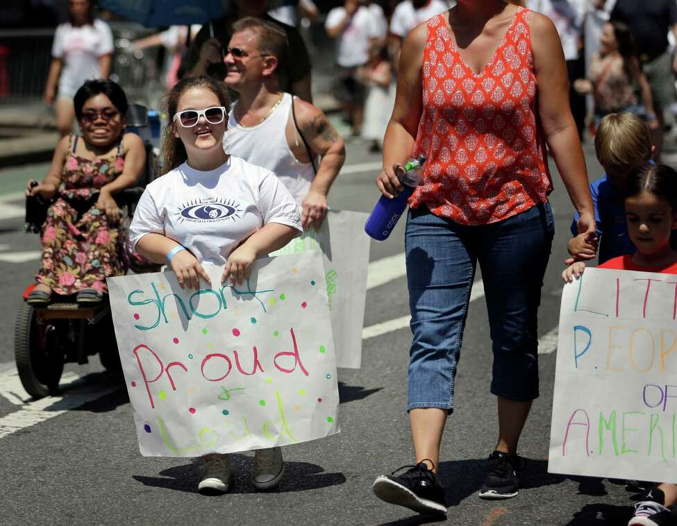Madison Ehler marches in the inaugural Disability Pride Parade, Sunday, July 12, 2015, in New York. The parade grand marshal was former U.S. Sen. Tom Harkin, the Iowa Democrat who 25 years ago sponsored the Americans With Disabilities Act. (AP Photo/Seth Wenig) ORG XMIT: NYSW113