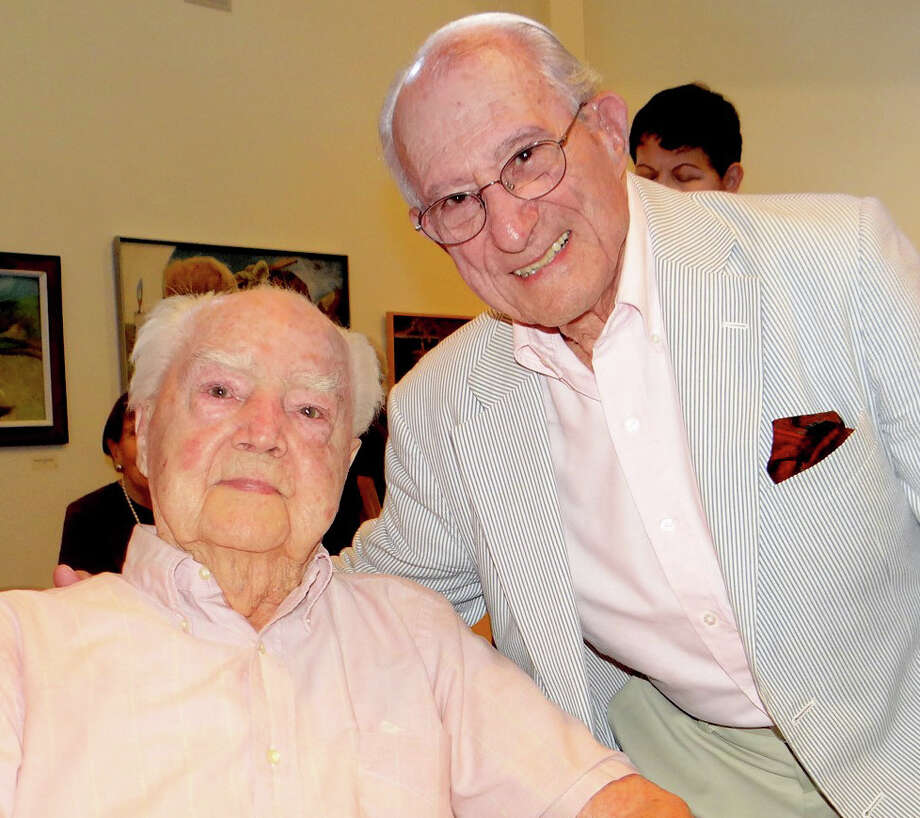 Howard Munce, left, who turns 100 this year, with Leonard Everett Fisher, who curated a new exhibit of Munce's work at the Westport Historical Society. Photo: Mike Lauterborn / For Hearst Connecticut Media / Westport News