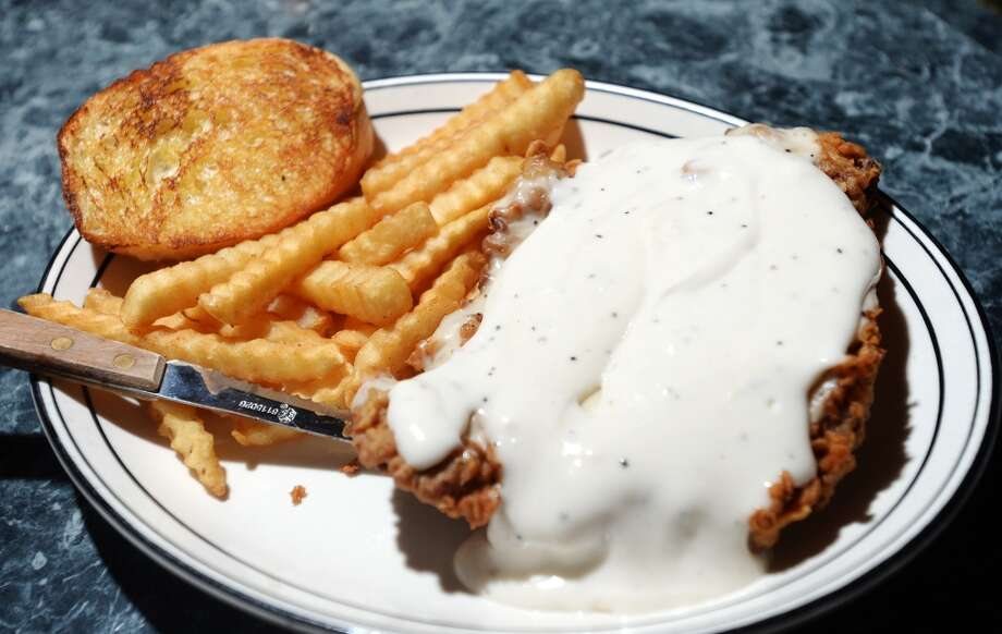 MacKenzie's Pub229 Dowlen Road, BeaumontPictured is MacKenzie's Pub's chicken fried steak, photographed on Sept. 16, 2014. MacKenzie's Pub is the Cat5 Bar of the Week for October 9, 2014. 