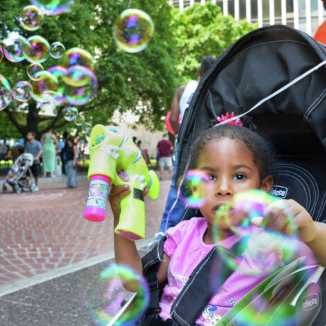 Three-year-old Ava Conyers of Green Island tries out her new bubble shooter during GE Kids Day At The Plaza Saturday July 11, 2015 at the Empire State Plaza in Albany, NY.  (John Carl D'Annibale / Times Union) Photo: John Carl D'Annibale, Albany Times Union