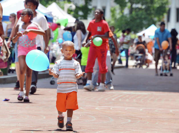 Two-year-old E'Jean Wells of Albany proudly carries his balloon during GE Kids Day At The Plaza Saturday July 11, 2015 at the Empire State Plaza in Albany, NY.  (John Carl D'Annibale / Times Union) Photo: John Carl D'Annibale, Albany Times Union