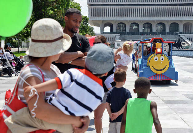 Kids and parents queue up to take a ride on the Roaming Railroad during GE Kids Day At The Plaza Saturday July 11, 2015 at the Empire State Plaza in Albany, NY.  (John Carl D'Annibale / Times Union) Photo: John Carl D'Annibale, Albany Times Union