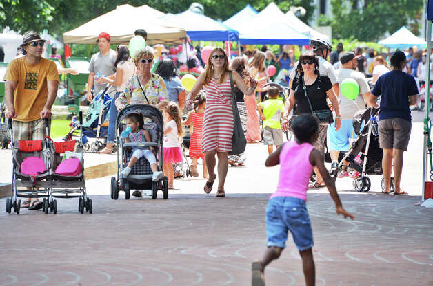Families stroll the plaza during GE Kids Day At The Plaza Saturday July 11, 2015 at the Empire State Plaza in Albany, NY.  (John Carl D'Annibale / Times Union) Photo: John Carl D'Annibale, Albany Times Union