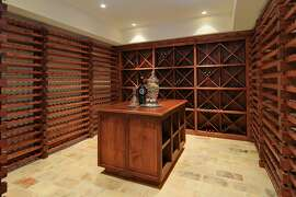 The temperature-controlled wine room can store roughly 5,000 bottles on its redwood racks.