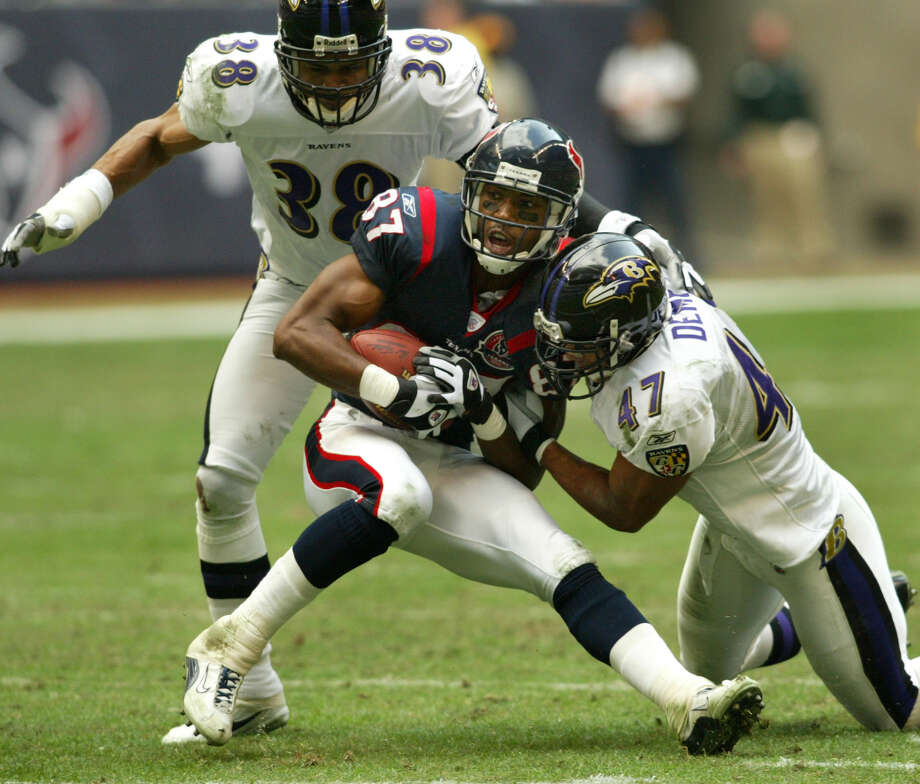 Baltimore Ravens safety Will Demps (#47) stops Houston Texans wide receiver JaJuan Dawson (#87) as Baltimore Ravens corner back James Trapp (#38) closes in during fourth quarter action Sunday afternoon, Dec. 15, 2002, at Reliant Stadium in Houston.  The Ravens defeated the Texans 23-19. (digital photo by Kevin Fujii/Chronicle) Photo: KEVIN FUJII, HOUSTON CHRONICLE / HOUSTON CHRONICLE